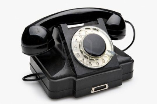 10126836-old-black-vintage-rotary-style-telephone-isolated-over-a-white-background