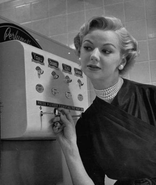 coin-operated-perfume-dispenser-1952