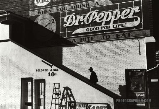 african_american_man_going_in_colored_entrance_of_movie_theater_on_saturday_afternoon._belzoni_mississippi._1939_october