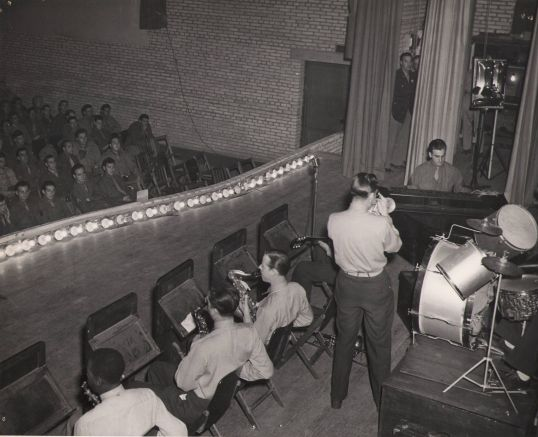 Joe E. Brown entertains allied troops in the middle east
